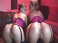 He cums across two lovely asses