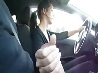 Stunning lady strokes cock while driving