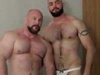 Muscle dudes pose naked