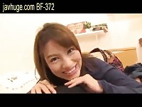 Little Japanese doll strokes dick with her stockinged feet