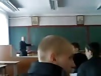 Schoolgirl jerks her boyfriend in the classroom