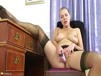 Blonde office lady in pantyhose and miniskirt plays with herself