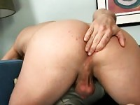 Handsome stud caresses his fiery anal hole and strokes his long dick