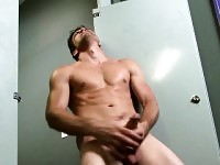 Muscled beefcake Jack King gets naked to jack off in the toilet