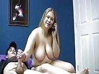 BBW blonde jerks off her man while on the phone
