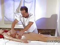 Busty blonde fucks masseur in reverse position
