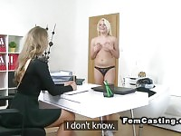Female agent fucks blonde with dildo