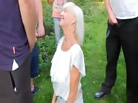 older woman gets gangbanged in the middle of the woods.