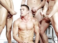 Four attractive and horny friends get together for a torrid gay orgy