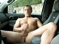 Attractive guy with a ripped body makes himself cum hard in the truck