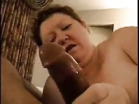 Orny amateur milf providing a blowjob