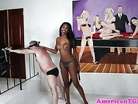 Dominant bigtitted black tranny flogs dude