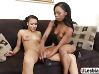 Black lesbos sharing a fat dildo in rough manners during their sexy play