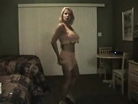 Hot blonde milf does a striptease