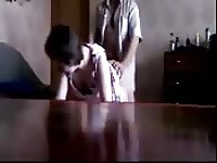 Cheating milf fucked over the table.