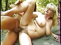 Kinky old broad gets boffed in the woods.