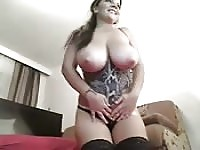 Happy harlot shows off her outstanding knockers.