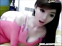 Gorgeous Asian cam girl teases with a toy.