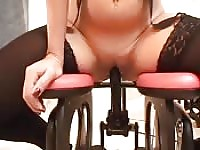 Horny brunette sits on a chair made to fuck her mindless