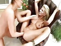 Squirting lesbian screams with pleasure as she's fisted