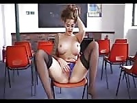 Sexy MILF teacher sits and strips and masturbates without a hotcock.