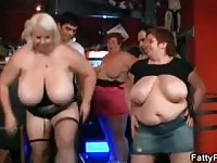 Three fat chicks have fun in the bar.