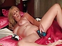 Hot granny fucks her pussy with a sex toy.